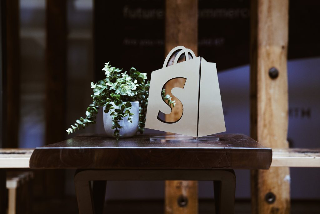 shopify logo window with plant